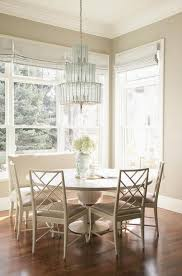 monochromatic breakfast room transitional dining room round table with bench seating