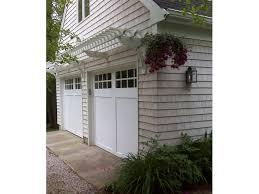 2 pergola above garage doors