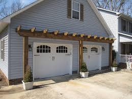 garage door arborVinyl Arbor Over Garage Door  Landscape Design  Pinterest
