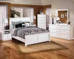 white modern bedroom in wooden floor
