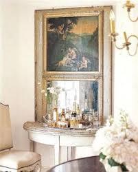 jane moore veranda bar on demi lune table tucked under two part mirror