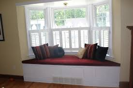 Living Room:Spacious Bay Window Design With Red Window Seat And Laminated  Wooden Floor Easy