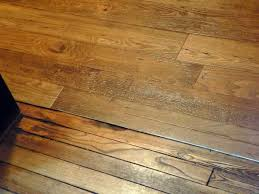 plank flooring that looks like wood this stuff looks great sheet vinyl next to real wood armstrong rhythms