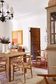 dining room with danish wishbone or y chairs in reese witherspoon s spanish hacienda house in home