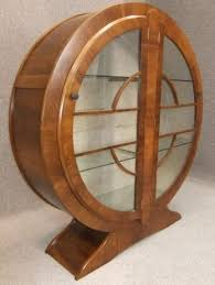 art deco furniture. a classic art deco furniture of the period this beautiful circular china cabinet constructed walnut and glass stands upon an outswept base has twin s