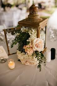 Amazing lantern centerpiece with flowers cascading out! View the full  wedding here: http:
