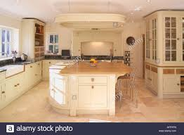 Neutral Kitchen Cream Tiled Floor In Modern Neutral Kitchen With Island Unit Stock