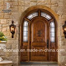 church gate style design exterior wood front doors with top carving glass