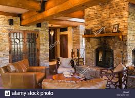 Natural Stone Fireplace Leather Chairs Next Four Sided Natural Stone Fireplace Wine Cellar