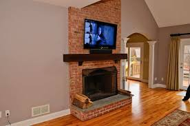 mounting tv above brick fireplace