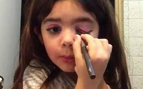 a five year old giving makeup tutorials
