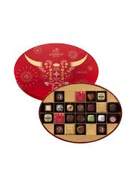 Chinese new year cookies and snacks are an integral part of the lunar new year celebrations. Chinese New Year Chocolate Tin Box 22pcs