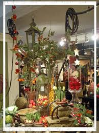 k k interiors is a favorite showroom of mine and robin s here s a great display with garden hoses ing down from the ceiling