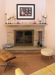 mid century modern fireplace with art