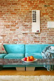 Contemporary sofas looks great against exposed brick walls in living rooms.