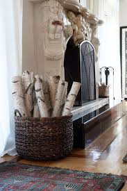 birch logs by fireplace cool idea