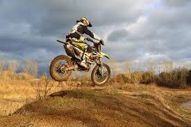 motocross rider on his dirt bike during daytime free stock photo