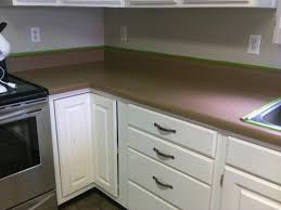 you can kind of see the pink tint in the second picture here is a comparison of the countertop with the color on the box not even close