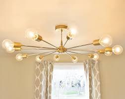 the shepard modern brass chandelier