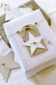 white & gold gift  That's a Wrap  diy ideas for gift packaging and wrapped  presents - white stars