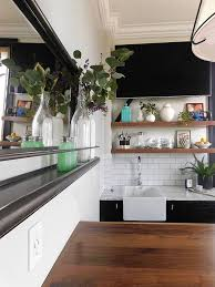 small black and white kitchen with slim wooden floating shelves
