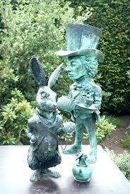 alice in wonderland garden in wonderland garden statue in wonderland statue stock image of gardens new