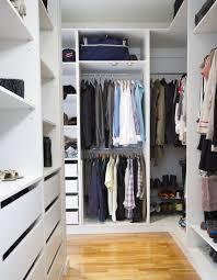 walk in closet with light wood floor