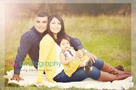 family of three outdoor field photography family photos posing ideas yellow colors
