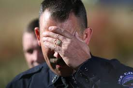 DLM00553 Park County Sheriff Fred Wegener puts his hand on his head during  a 4:00 p.m. press conference where he fielded questions about the letter  that was mailed by gunman Duane Morrison