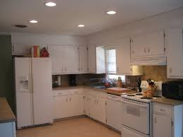 small kitchen decoration with white corner cabinet color design and granite countertop also using glass window ideas