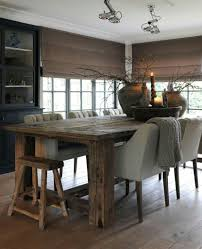 rustic dining table upholstered tufted chairs rustic stool large bowl and urns modern rustic dining e