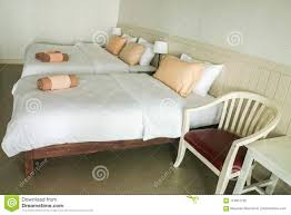 Light Bed Rest Double Bed In Luxury Bedroom With Armchair In Hotel For