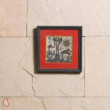 a ethnic wall frame with warli paint