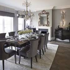 lovely formal dining room with area rug and upholstered chairs
