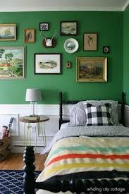 Cosy and elegant vintage styled boys bedroom with a very English feel.  Loving the green walls painted in Benjamin Moore& Bunker Hill green.