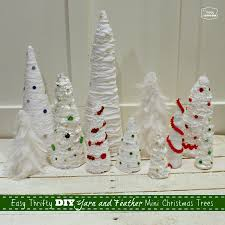Diy Christmas Tree Easy Thrifty Diy Mini Christmas Trees With Yarn And Feathers