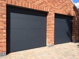 byron doors installs ryterna r40 flush slick style steel sectional garage doors finished in ral 7016