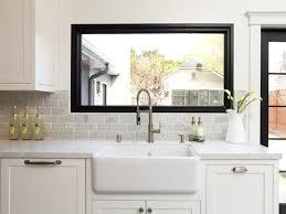 White Farmhouse Kitchen Grey countertops Apron front sink and
