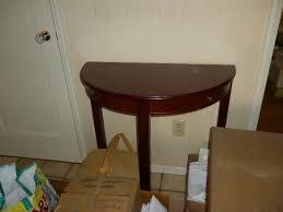 contemporary half round mahogany table