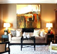 wall art above sofa breathtaking design dilemma what to hang on the big behind your home guimaraes behin