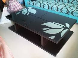 lacquered glass top center table at