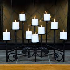 lovely black metal fireplace candelabra with ten white candle for home decoration ideas
