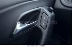 lock car door. Button Lock Car Doors And Door Openers - Stock Image