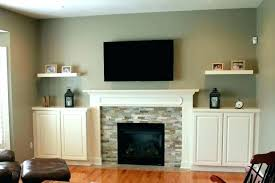 living room fireplace decor ideas tv above decorating mantel cabinets with awesome merry cool roo