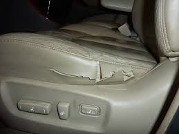a very used car that had leather seats all of the leather was in very good condition except the driver s seat worn and with a large tear on the side