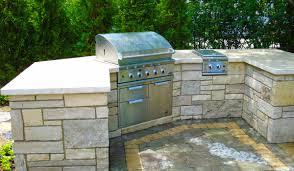 eden stone veneer with sanded edge indiana limestone coping outdoor kitchen