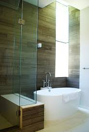 view in gallery modern bathroom featuring a tiny white tub and compact shower unit view