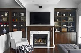 toronto wood built ins family room traditional with ottoman plastic acrylic storage bins and boxes tv above fireplace