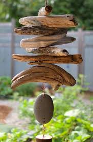 A natural Pacific beach stone and driftwood wind chime- naturally  beautiful.This wind chime measures about 55 inches long from the top of the  copper hanging ...