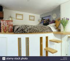 platform bed with steps.  Steps Steps Up To Platform Bed With Animalprint Bedcover In Small Studio  Apartment To Platform Bed With T